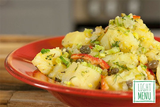 Potato salad with celery, red peppers, capers, mustard, lemon and fresh herbs