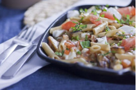 Gluten free penne with freshly chopped basil, tomato, eggplant and mozzarella cheese cubes