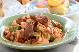 Veal stew with vegetables cooked in red wine and chylopites pasta from Arahova