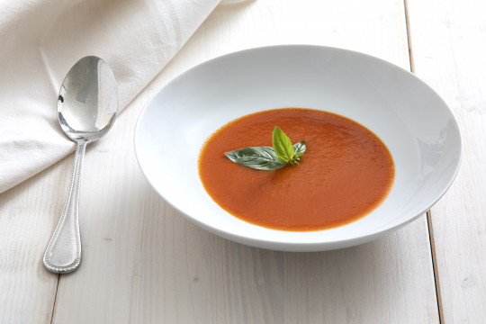 Tomato soup with fresh tomato and basil