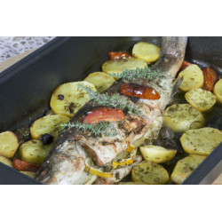 Roasted sea bass with lemon, capers, ginger & baked potatoes