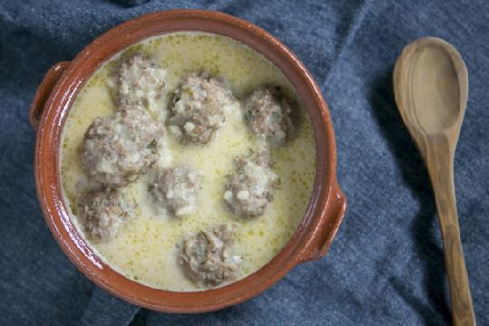 "Meatball soup ""Youvarlakia"" with egg-lemon sauce"