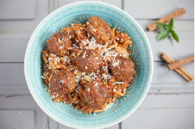 Meatballs in fresh tomato sauce with orzo pasta and parmesan