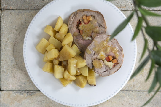 Stuffed pork with graviera cheese, carrots, peppers & roast potatoes