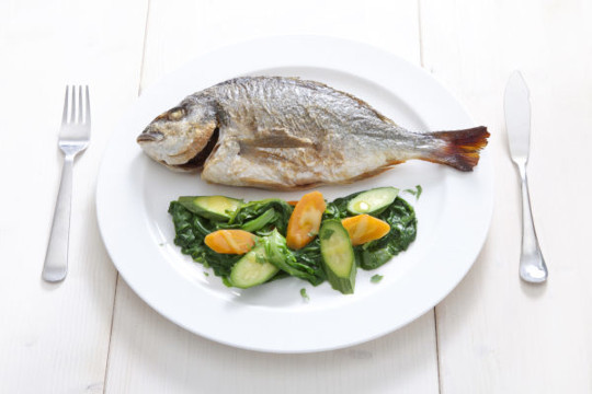 Sea bream with greens and boiled vegetables